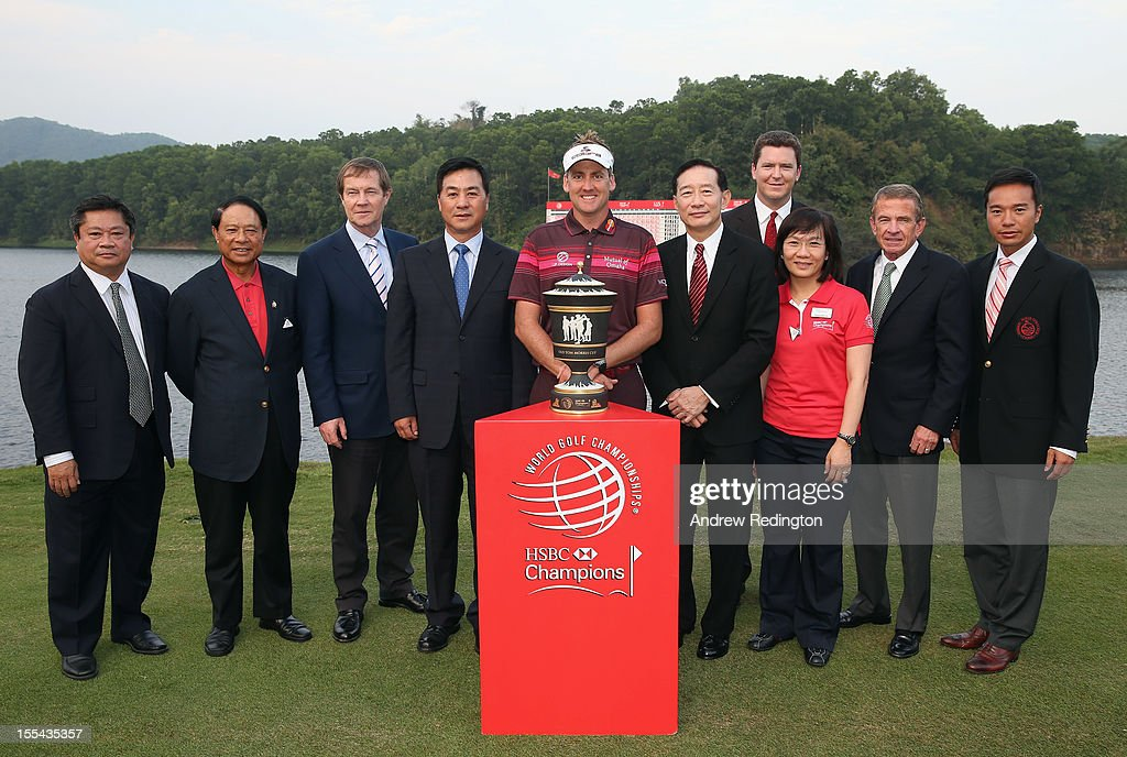 Ian Poulter of England poses with the trophy with dignitaries after winning the WGC HSBC Champions during the final round at the Mission Hills Resort on November 4, 2012 in Shenzhen, China.