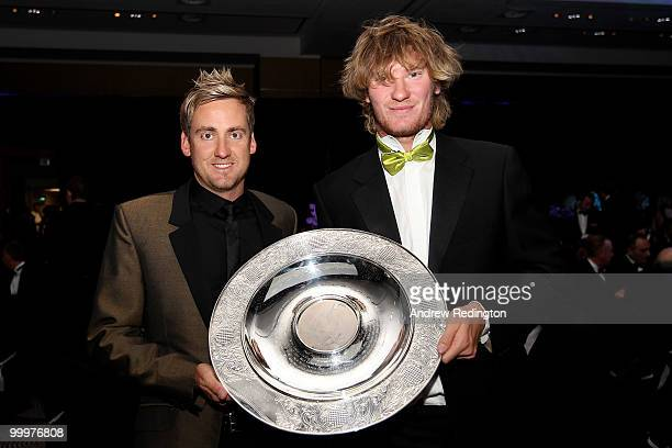 Ian Poulter of England presents the Rookie of the Year award to Chris Wood of England the 2010 Tour Dinner prior to the BMW PGA Championship on the...
