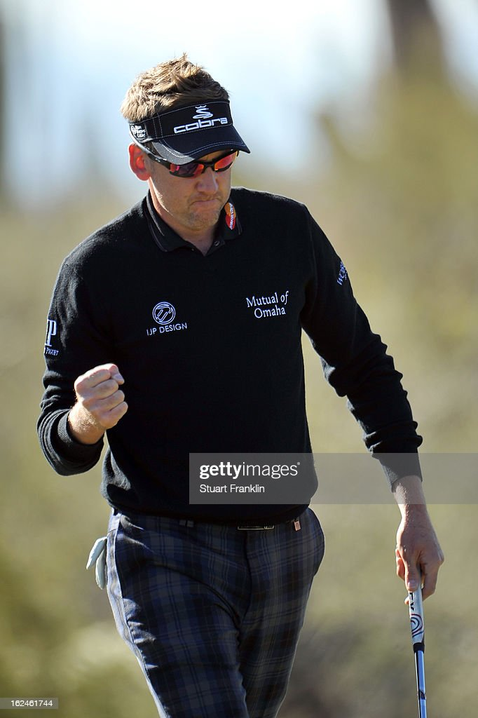 Ian Poulter of England reacts after he made a birdie putt to win the hole on the 12th hole green during the quarterfinal round of the World Golf Championships - Accenture Match Play at the Golf Club at Dove Mountain on February 23, 2013 in Marana, Arizona.