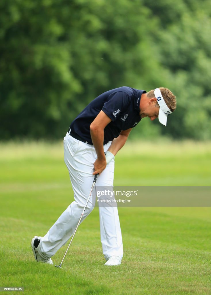 Ian Poulter of England reacts as he plays his second shot on the 4th hole during day three of the BMW PGA Championship at Wentworth on May 27, 2017 in Virginia Water, England.