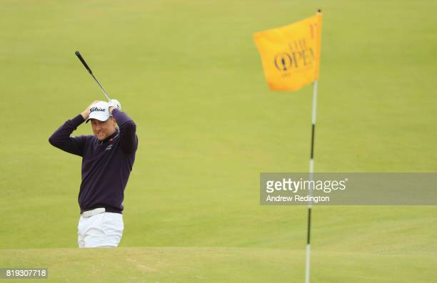 Ian Poulter of England reacts as he plays his third shot on the 17th hole during the first round of the 146th Open Championship at Royal Birkdale on...
