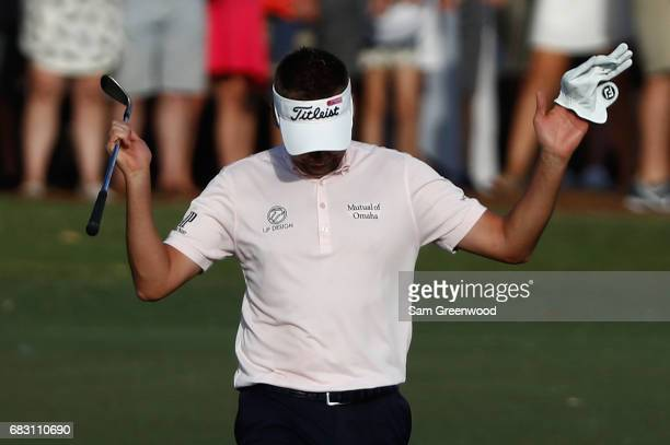 Ian Poulter of England reacts on the 18th hole during the final round of THE PLAYERS Championship at the Stadium course at TPC Sawgrass on May 14...