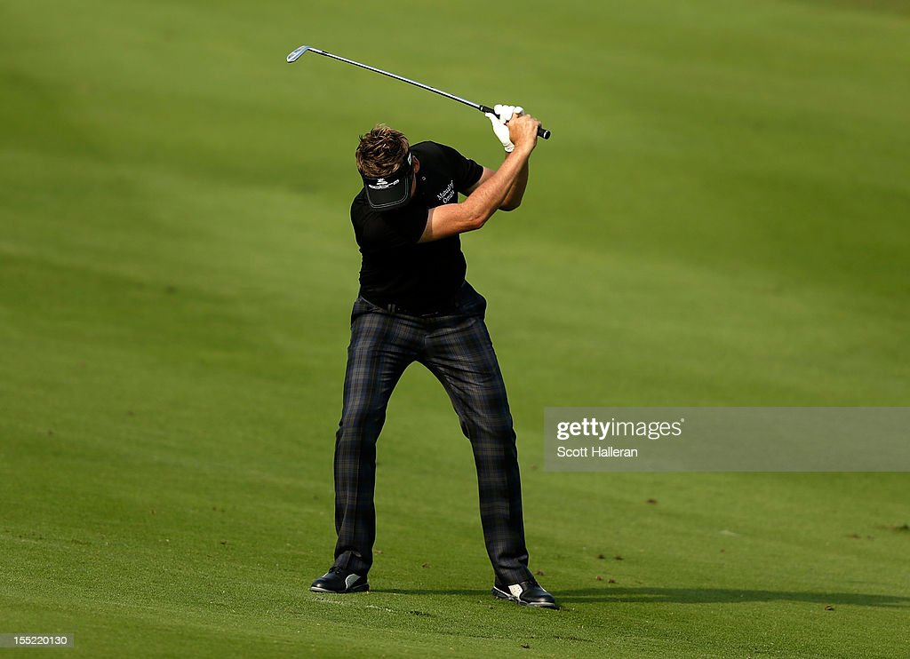 <a gi-track='captionPersonalityLinkClicked' href=/galleries/search?phrase=Ian+Poulter&family=editorial&specificpeople=171444 ng-click='$event.stopPropagation()'>Ian Poulter</a> of England reacts to a poor shot on the 18th hole during the second round of the WGC HSBC Champions at the Mission Hills Resort on November 2, 2012 in Shenzhen, China.