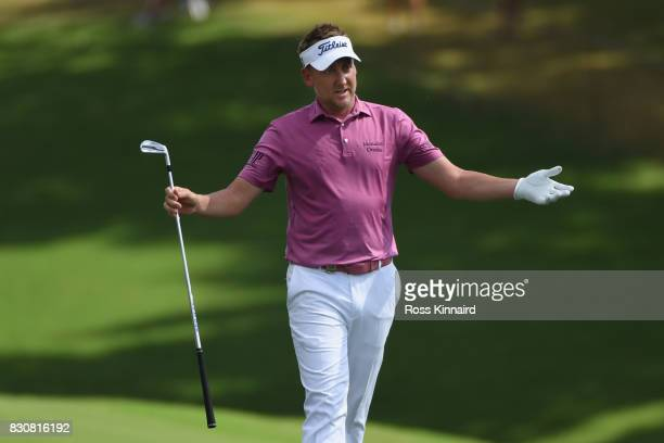 Ian Poulter of England reacts to his second shot on the 18th hole during the third round of the 2017 PGA Championship at Quail Hollow Club on August...