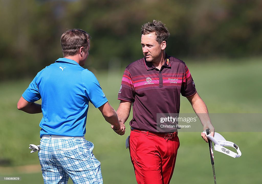 Ian Poulter (R) of England shakes hands with Jonas Blixt of Sweden following the replay of the first round of the Hyundai Tournament of Champions at the Plantation Course on January 7, 2013 in Kapalua, Hawaii.