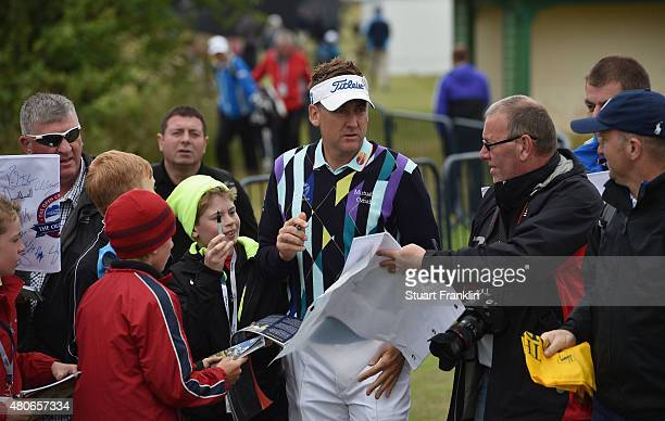 Ian Poulter of England signs autographs ahead of the 144th Open Championship at The Old Course on July 14 2015 in St Andrews Scotland
