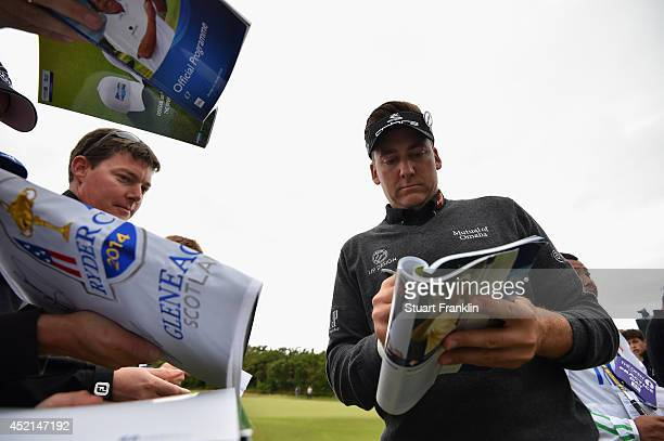 Ian Poulter of England signs autographs for fans during a practice round prior to the start of the 143rd Open Championship at Royal Liverpool on July...