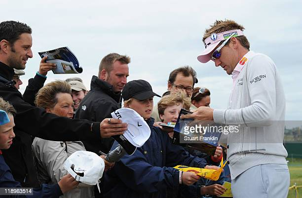Ian Poulter of England signs autographs for fans during the final practice round during The Open Championship at Royal St George's on July 13 2011 in...