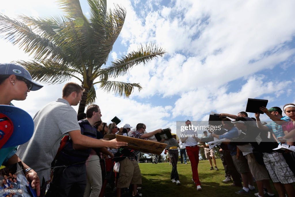 Ian Poulter of England sings autographs during practice ahead of the WGC - Cadillac Championship at the Doral Golf Resort & Spa on March 6, 2013 in Miami, Florida.