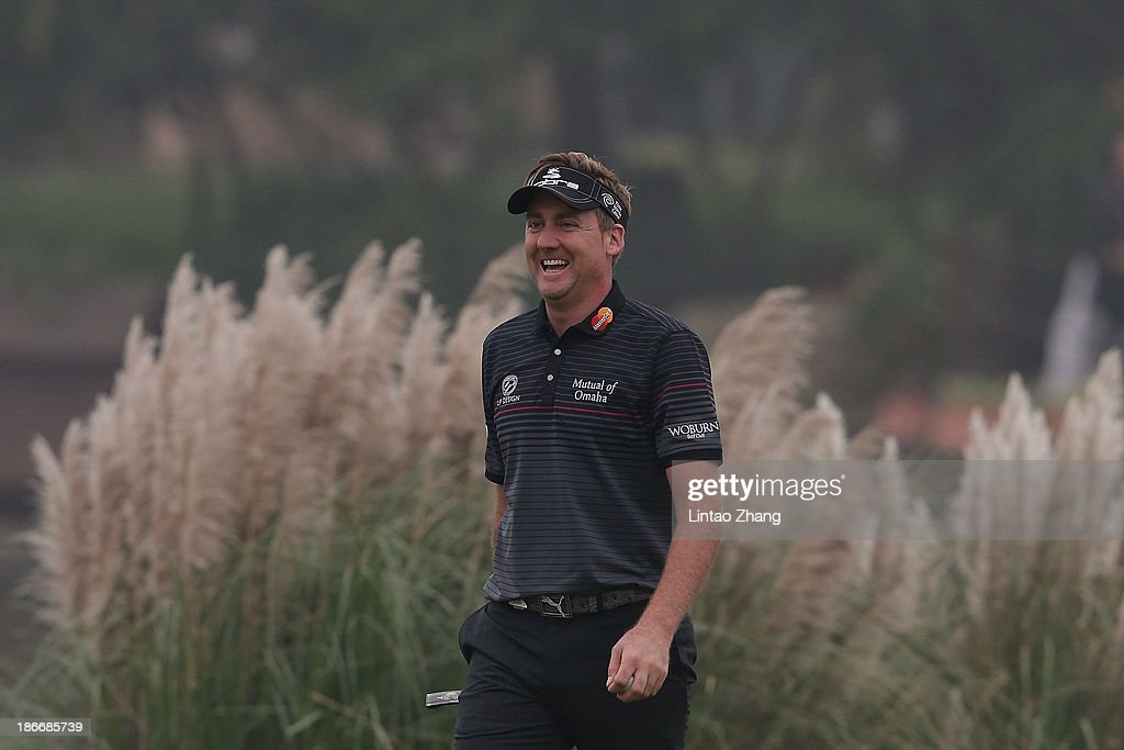 Ian Poulter of England smiles after a birdie putt during the final round of the WGC - HSBC Champions at the Sheshan International Golf Club on November 3, 2013 in Shanghai, China.