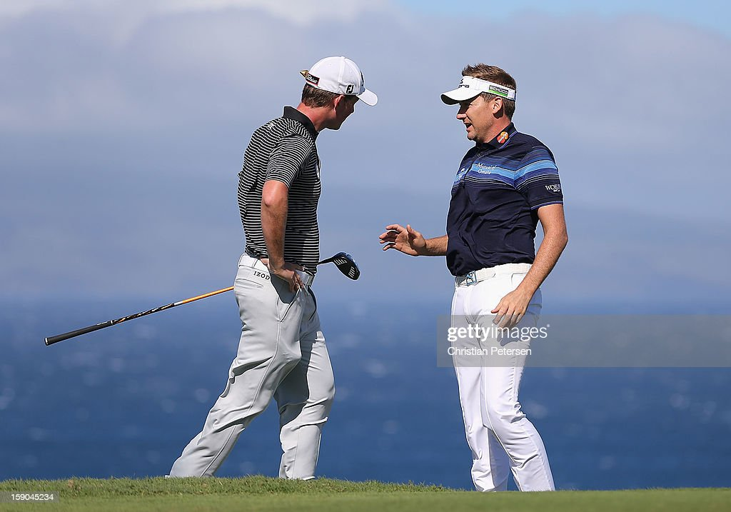Ian Poulter (R) of England talks with Webb Simpson on the 10th hole during the replay of the first round of the Hyundai Tournament of Champions at the Plantation Course on January 6, 2013 in Kapalua, Hawaii.