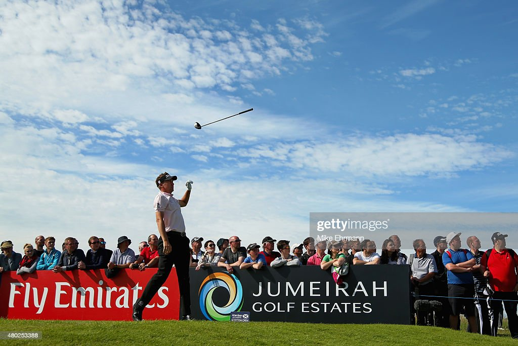 Ian Poulter of England tosses his club in the air after hitting his tee shot on the 16th hole during the second round of the Aberdeen Asset Management Scottish Open at Gullane Golf Club on July 10, 2015 in Gullane, East Lothian, Scotland.