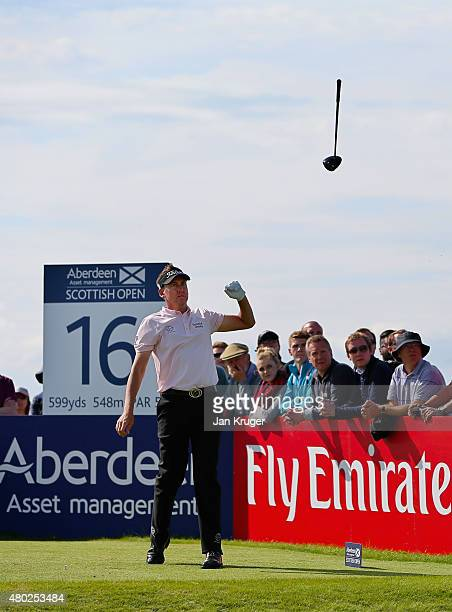 Ian Poulter of England tosses his club in the air after hitting his tee shot on the 16th hole during the second round of the Aberdeen Asset...