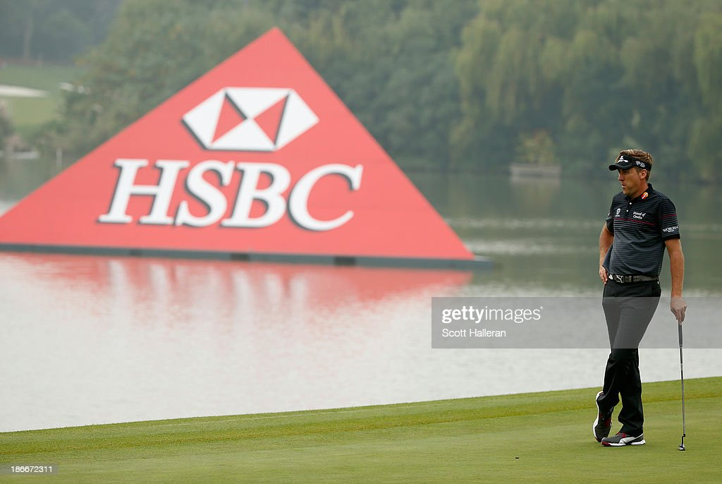 Ian Poulter of England waits on the ninth green during the final round of the WGC-HSBC Champions at the Sheshan International Golf Club on November 3, 2013 in Shanghai, China.