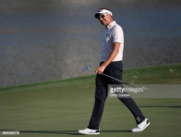 Ian Poulter of England walks onto the 17th hole during the final round of THE PLAYERS Championship on THE PLAYERS Stadium Course at TPC Sawgrass on...