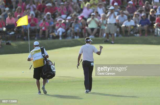 Ian Poulter of England walks to the 18th green during the final round of the THE PLAYERS Championship on the Stadium Course at TPC Sawgrass on May 14...