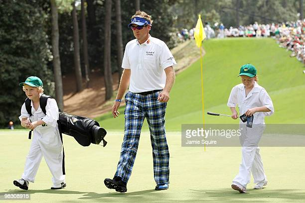 Ian Poulter of England walks with his children AimeeLeigh and Luke James during the Par 3 Contest prior to the 2010 Masters Tournament at Augusta...