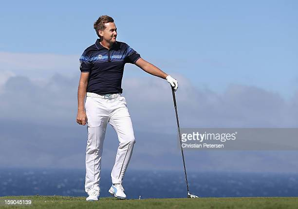 Ian Poulter of England watches his tee shot on the 10th hole during the replay of the first round of the Hyundai Tournament of Champions at the...