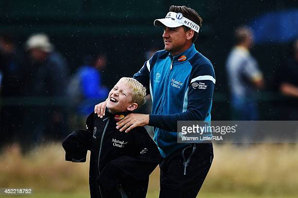 Ian Poulter of England with son Luke joke during a practice round prior to the start of the 143rd Open Championship at Royal Liverpool on July 16...