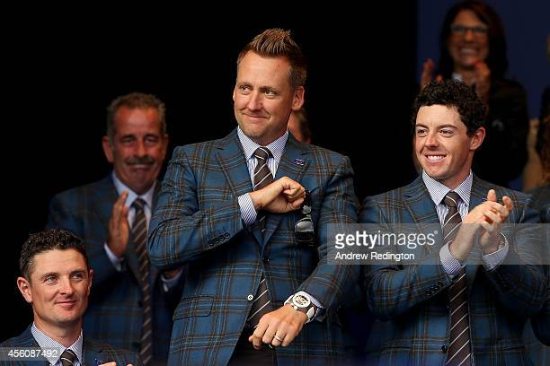 Ian Poulter of Europe acknowledges the crowd alongside Justin Rose and Rory McIlroy as he is introduced during the Opening Ceremony ahead of the 40th...