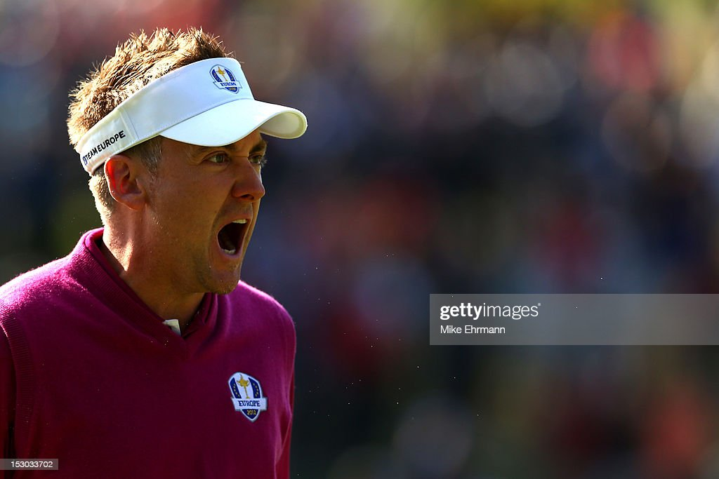 <a gi-track='captionPersonalityLinkClicked' href=/galleries/search?phrase=Ian+Poulter&family=editorial&specificpeople=171444 ng-click='$event.stopPropagation()'>Ian Poulter</a> of Europe celebrates after holing a putt on the 12th hole during day two of the Morning Foursome Matches for The 39th Ryder Cup at Medinah Country Club on September 29, 2012 in Medinah, Illinois.