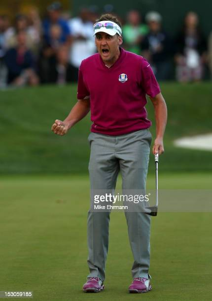 Ian Poulter of Europe celebrates after making birdie on the 16th green during day two of the Afternoon FourBall Matches for The 39th Ryder Cup at...