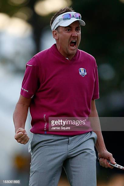 Ian Poulter of Europe celebrates after making birdie on the 18th green to help the Poulter/McIlroy team defeat the Dufner/Johnson team 1up during day...