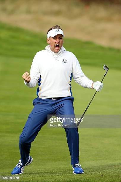 Ian Poulter of Europe celebrates chipping in on the 15th hole during the Morning Fourballs of the 2014 Ryder Cup on the PGA Centenary course at the...
