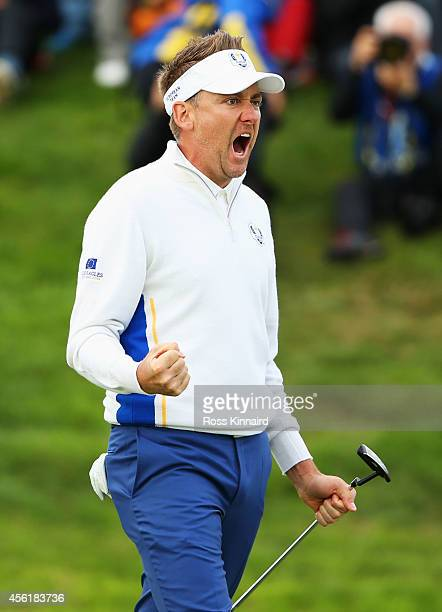 Ian Poulter of Europe celebrates his birdie on the 16th hole during the Morning Fourballs of the 2014 Ryder Cup on the PGA Centenary course at the...