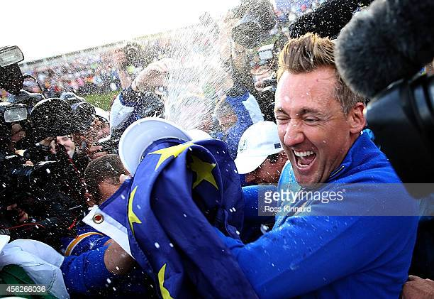 Ian Poulter of Europe celebrates winning the Ryder Cup after the Singles Matches of the 2014 Ryder Cup on the PGA Centenary course at the Gleneagles...