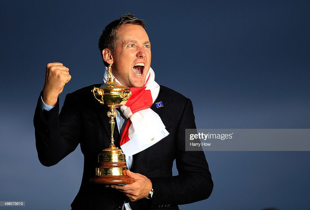 Ian Poulter of Europe poses with the Ryder Cup trophy after the Singles Matches of the 2014 Ryder Cup on the PGA Centenary course at the Gleneagles...