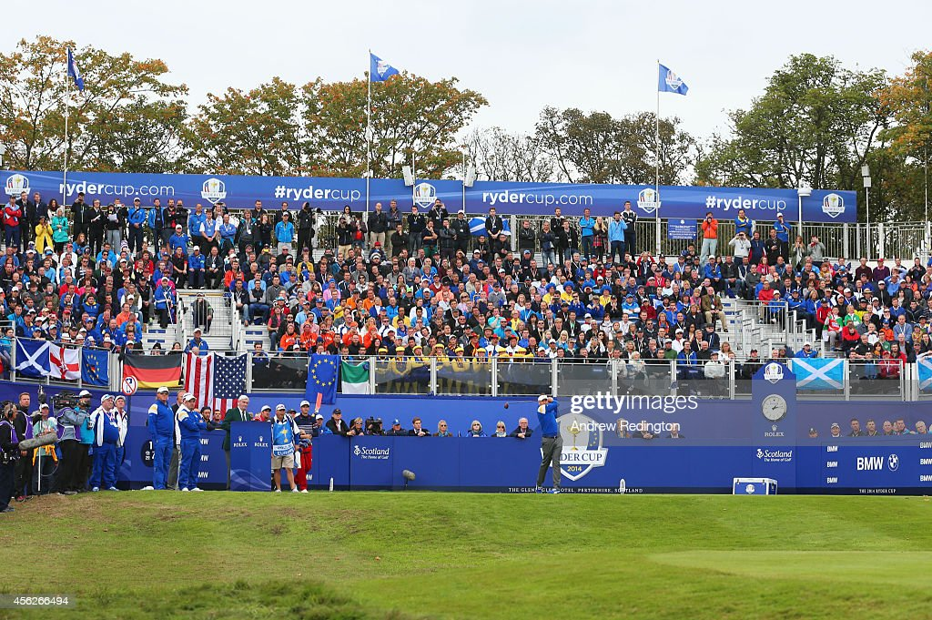 Ian Poulter of Europe tees off on the first hole during the Singles Matches of the 2014 Ryder Cup on the PGA Centenary course at the Gleneagles Hotel...