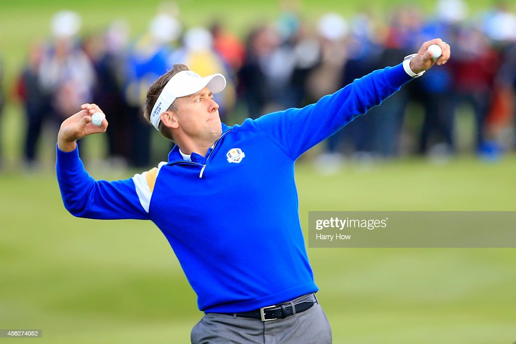 <a gi-track='captionPersonalityLinkClicked' href=/galleries/search?phrase=Ian+Poulter&family=editorial&specificpeople=171444 ng-click='$event.stopPropagation()'>Ian Poulter</a> of Europe throws a ball into the crowd on the 18th hole during the Singles Matches of the 2014 Ryder Cup on the PGA Centenary course at the Gleneagles Hotel on September 28, 2014 in Auchterarder, Scotland.