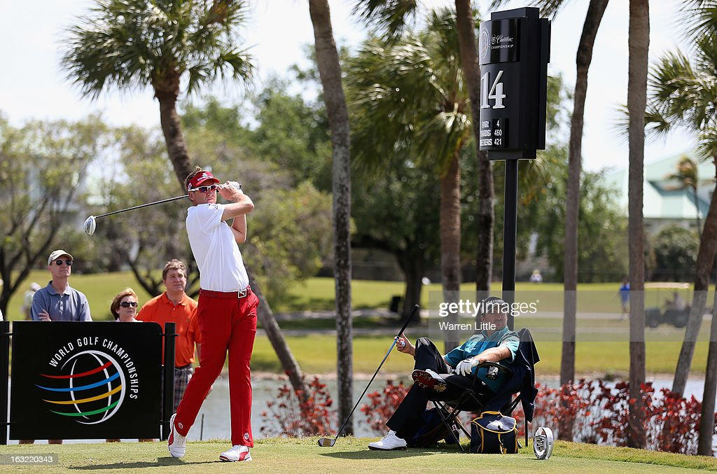 Ian Poulter oif England tees off as Graeme McDowell of Northern Ireland looks on from a chair during practice ahead of the WGC - Cadillac Championship at the Doral Golf Resort & Spa on March 6, 2013 in Miami, Florida.