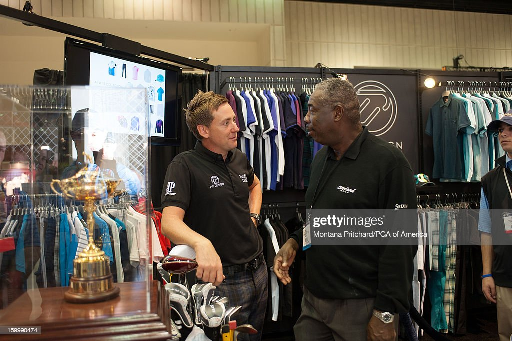 <a gi-track='captionPersonalityLinkClicked' href=/galleries/search?phrase=Ian+Poulter&family=editorial&specificpeople=171444 ng-click='$event.stopPropagation()'>Ian Poulter</a> speaks to a guest in the IJP Design booth during the 60th PGA Merchandise Show on January 24, 2013 at The Orange County Convention Center in Orlando, Florida.