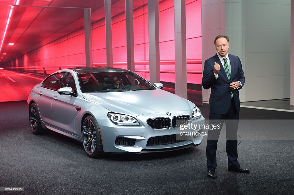 Ian Robertson, BMW management board member in charge of sales and marketing, introduces the BMW M6 Gran Coupe at the 2013 North American International Auto Show in Detroit, Michigan, January 14, 2013. AFP PHOTO/Stan HONDA