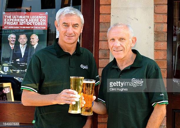 Ian Rush and Peter Reid pose for photos during the Carlsberg Ultimate Legends Pub Experience at The Crown pub on October 12 2012 in Lichfield England...