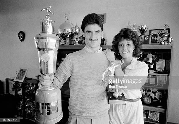 Ian Rush of Juventus and his girlfriend Tracy with the Sports Writers Footballer of the Year and the PFA Player of the Year trophies at home near...