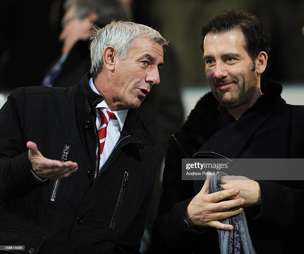 Ian Rush of Liverpol and actor Clive Owen watch from the stands during the Barclays Premier League match between Queens Park Rangers and Liverpool at Loftus Road on December 30, 2012 in London, England.