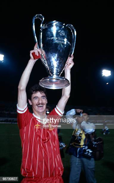 Ian Rush of Liverpool celebrates with the European Cup after Liverpool beat Roma 42 on penalties in the European Cup Final held at the Olympic...
