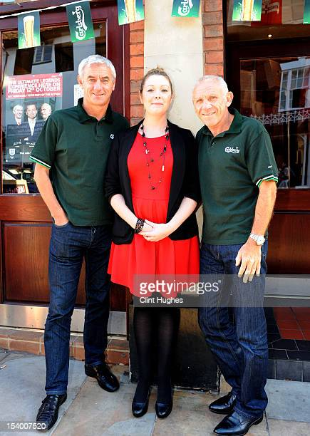 Ian Rush pub landlady Sarahanne George and Peter Reid pose for photos during the Carlsberg Ultimate Legends Pub Experience at The Crown pub on...