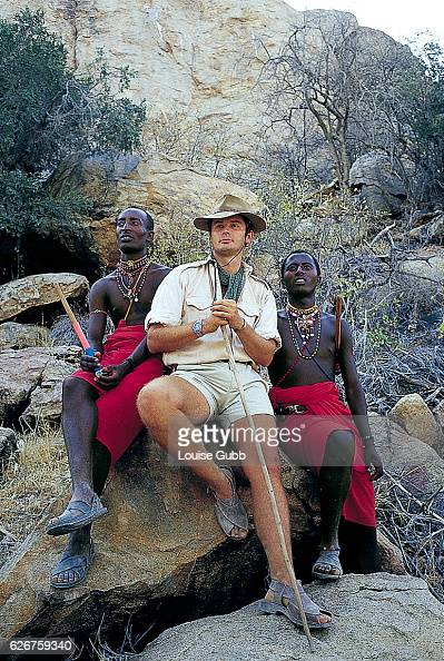 Ian Saunders a former British military officer and longtime African wilderness guide sits with two Masai assistants Saunders was hired by 'Survivor...