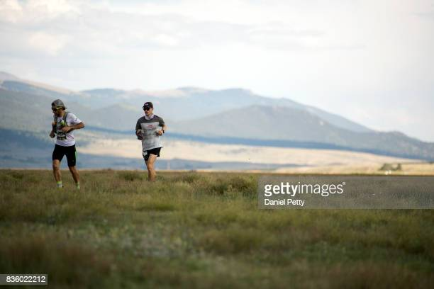Ian Sharman and his pacer run toward the Outward Bound/Fish Hatchery aid station at mile 745 during the Leadville 100 trail run on August 19 in...