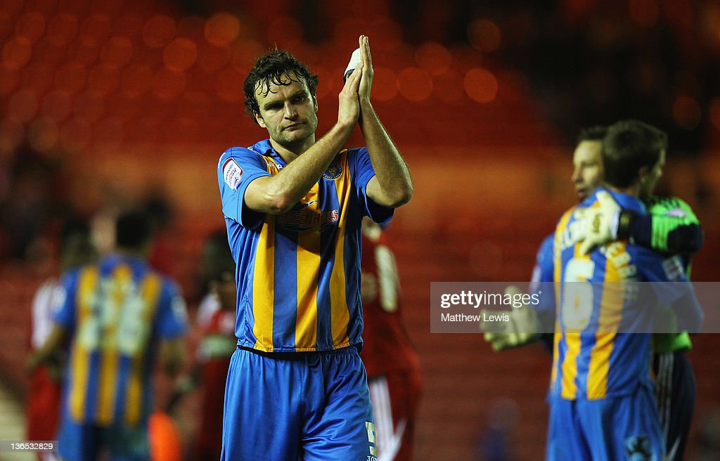 Ian Sharps, captain of Shrewsbury Town applauds the travelling supporters, after his team lost to Middlesbrough during the FA Cup Third Round match between Middlesbrough and Shrewsbury Town at Riverside Stadium on January 7, 2012 in Middlesbrough, England.