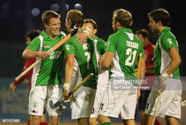 Ian Sloan and Michael Watt of Ireland celebrate Watts' goal during the FIH Olympic Games Qualifying Tournament at the Belfield Dublin