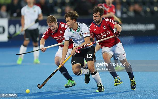 Ian Sloan of Great Britain Timm Herzbruch of Germany and Adam Dixon of Great Britain during the FIH Mens Hero Hockey Champions Trophy match between...
