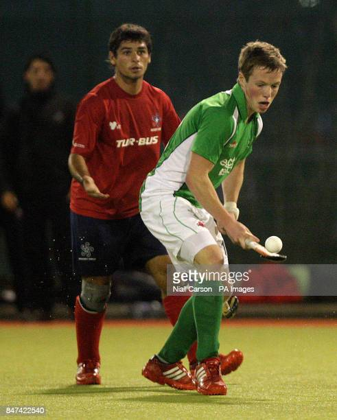Ian Sloan of Ireland and Sven Richter of Chile during the FIH Olympic Games Qualifying Tournament at the Belfield Dublin PRESS ASSOCIATION Photo...