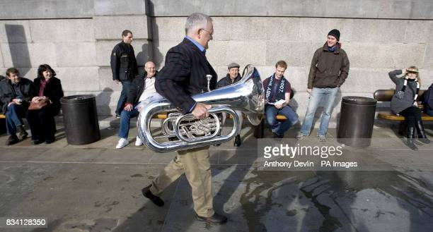 Ian Smith arrives to join hundreds of brass band musicians in Trafalgar Square to peform the theme tune of Australian soap Neighbours to celebrate...