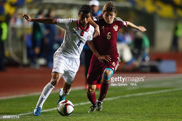Ian Smith of Costa Rica is challenged by Ivan Galanin of Russia during the FIFA U17 World Cup Chile 2015 Group E match between Russia and Costa Rica...