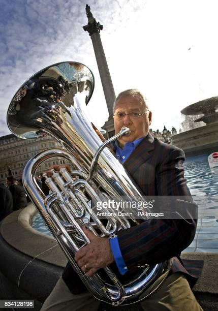 Ian Smith poses for media before joining hundreds of brass band musicians from around the UK performing the Neighbours theme tune to celebrate the...